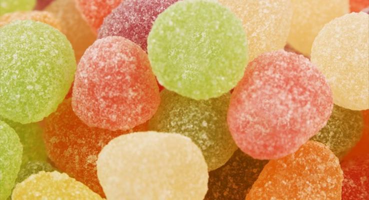 五彩缤纷看上去就好好吃的球形软糖糖果PPT背景